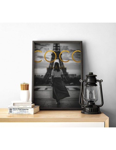 Poster COCO CHANEL with golden inscriptions and a photo of Paris in black and white