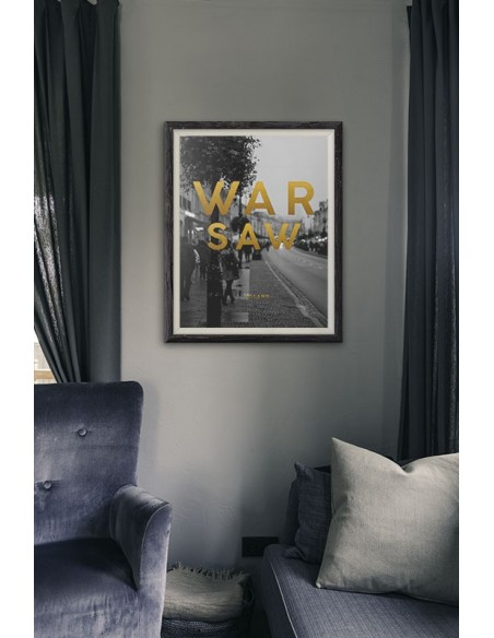 Poster with Warsaw and gold subtitles. Black and white picture of Warsaw and subtitles