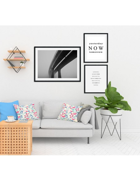 Prints on the wall in the form of a poster with a photograph of the bridge in the fog. Black and white picture