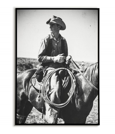 A poster with a cowboy. Old photo, artwork for the frame. Black and white photo with a horse and a cowboy.